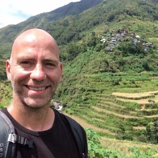 Syl Primeau climbing rice terraces in Batad, Philippines